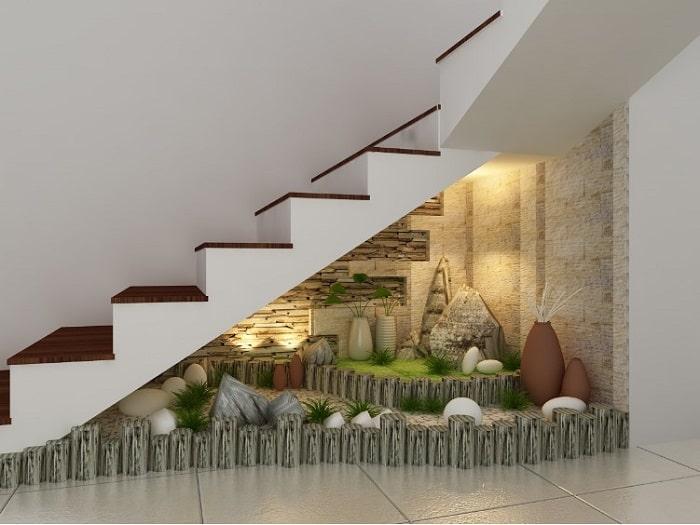 Sử dụng gầm cầu thang để trang trí thay vì đặt nhà vệ sinh